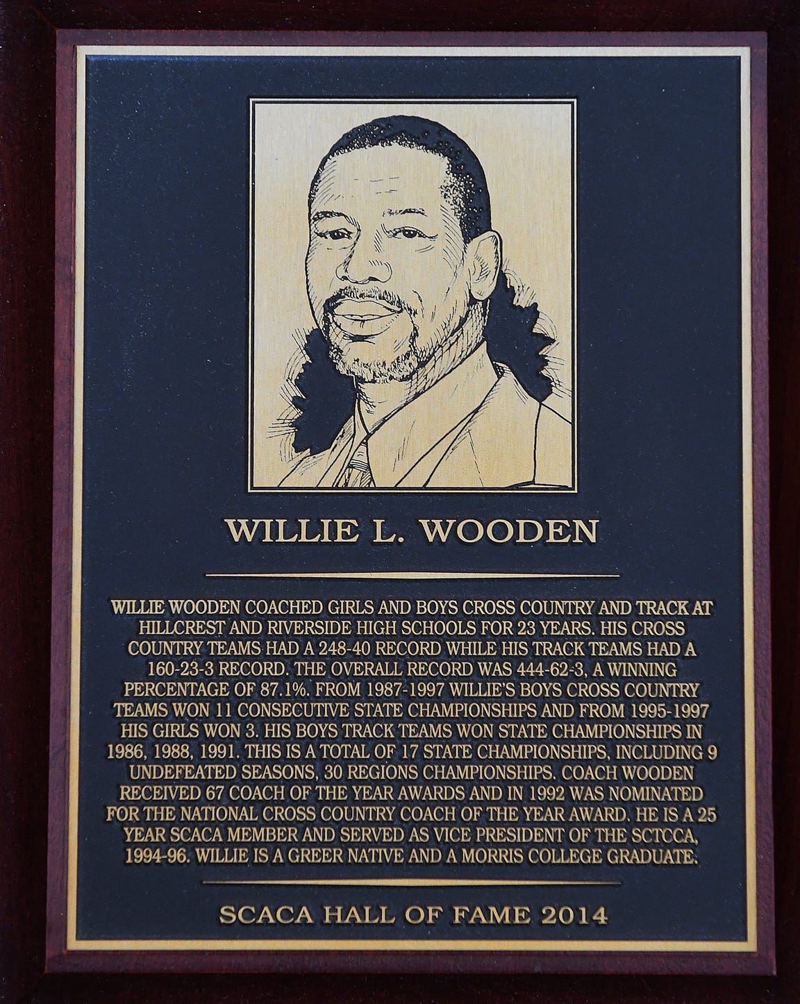 This is Willie Wooden's plaque from the South Carolina Athletic Coaches Association Hall of Fame. He's a member of three others: South Carolina Track and Cross Country Coaches Association, Piedmont Athletic Association and Riverside High School. BART BOATWRIGHT/STAFF