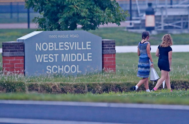 Students arrive for the first day of school, Wednesday, Aug. 1, 2018, at Noblesville West Middle School.