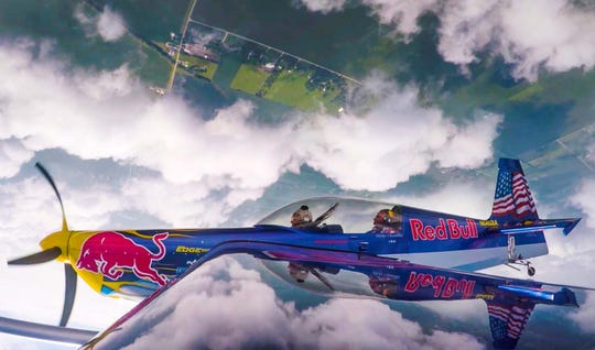 Former Indiana Fever player Tamika Catchings rode along with Red Bull Air Race pilot Kirby Chambliss on Wednesday.