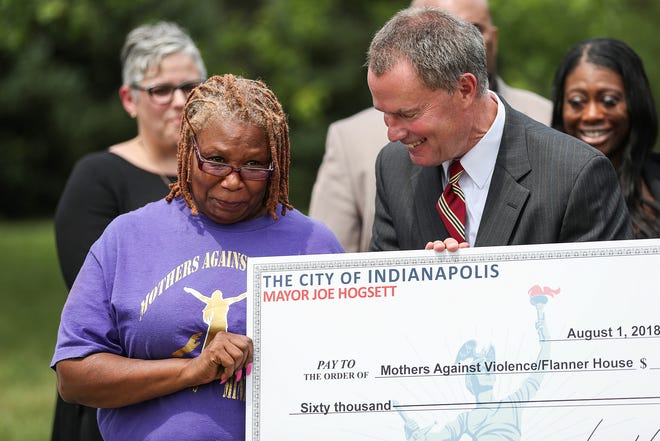 Donita Royal, president of Mothers Against Violence Healing Ministry, becomes emotional as she receives $60,000 from Mayor Joe Hogsett on behalf of the organization at Washington Park in Indianapolis, Wednesday, August 1, 2018. Hogsett, the Office of Public Health and Safety and the Indianapolis Metropolitan Police Department awarded $300,000 in grant funding to community organizations with programming focused on violence intervention.