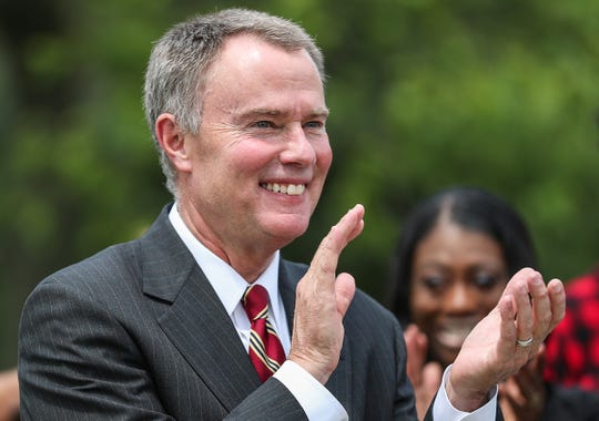 Mayor Joe Hogsett claps as organizations are congratulated for being chosen as grant recipients, at Washington Park in Indianapolis, Wednesday, August 1, 2018. Hogsett, the Office of Public Health and Safety and the Indianapolis Metropolitan Police Department awarded $300,000 in grant funding to community organizations with programming focused on violence intervention.