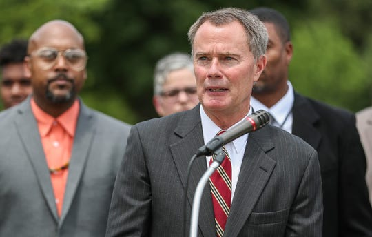 Mayor Joe Hogsett speaks at Washington Park in Indianapolis, Wednesday, August 1, 2018. Hogsett, the Office of Public Health and Safety and the Indianapolis Metropolitan Police Department awarded $300,000 in grant funding to community organizations with programming focused on violence intervention.