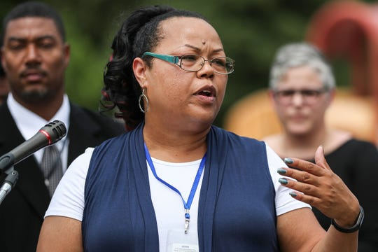 Shonna Majors, Indianapolis' first community violence reduction director, speaks at Washington Park in Indianapolis, Wednesday, August 1, 2018. Mayor Joe Hogsett, the Office of Public Health and Safety and the Indianapolis Metropolitan Police Department awarded $300,000 in grant funding to community organizations with programming focused on violence intervention. Majors is laregly responsible for allocating the funds and hopes to make funds more accessible to community organizations.