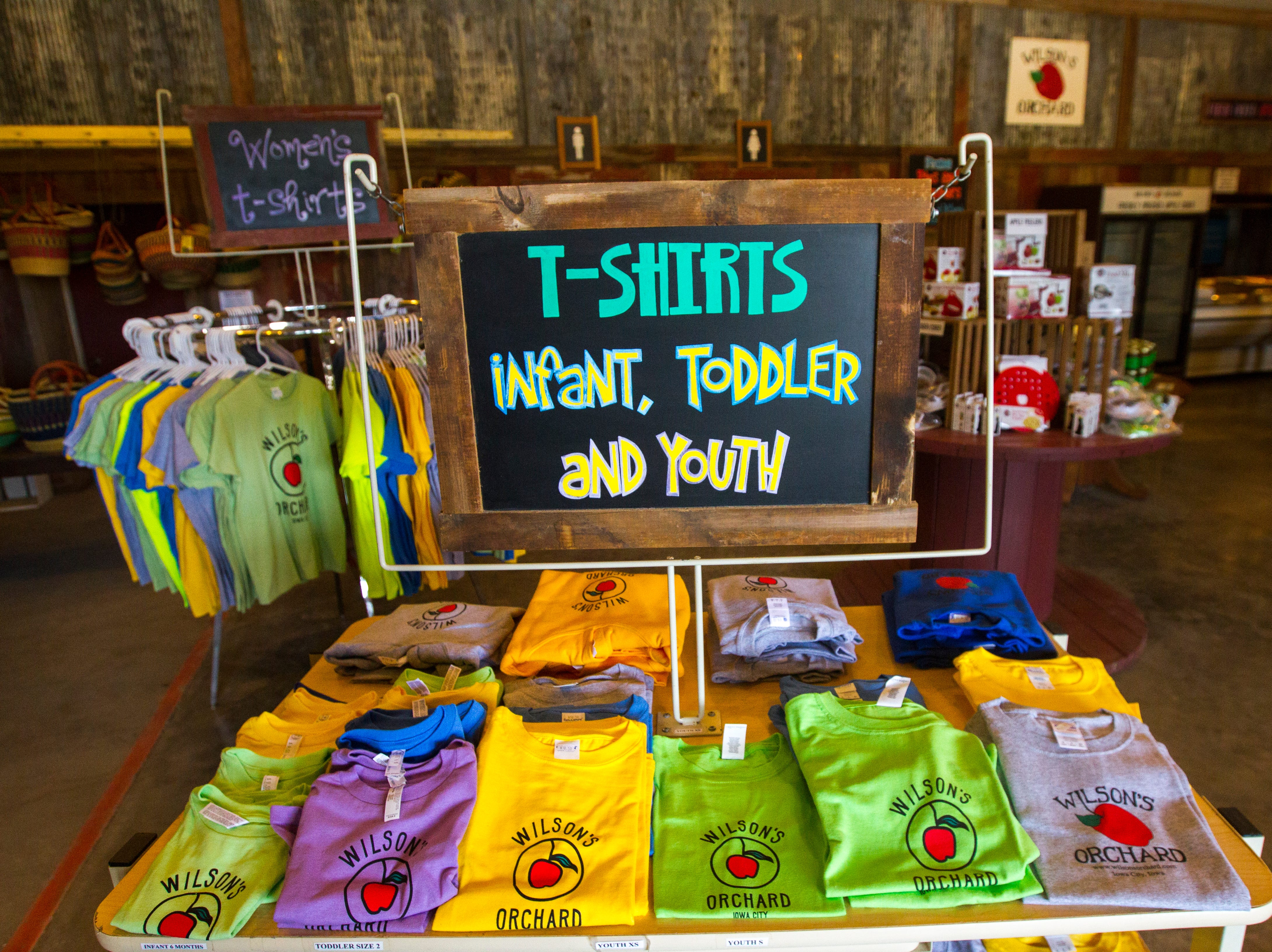 Merchandise is displayed on Wednesday, Aug. 1, 2018, at Wilson's Apple Orchard in Iowa City, Iowa. The orchard is open from Aug. 1 through Oct. 31, 10 a.m. to 6 p.m daily.