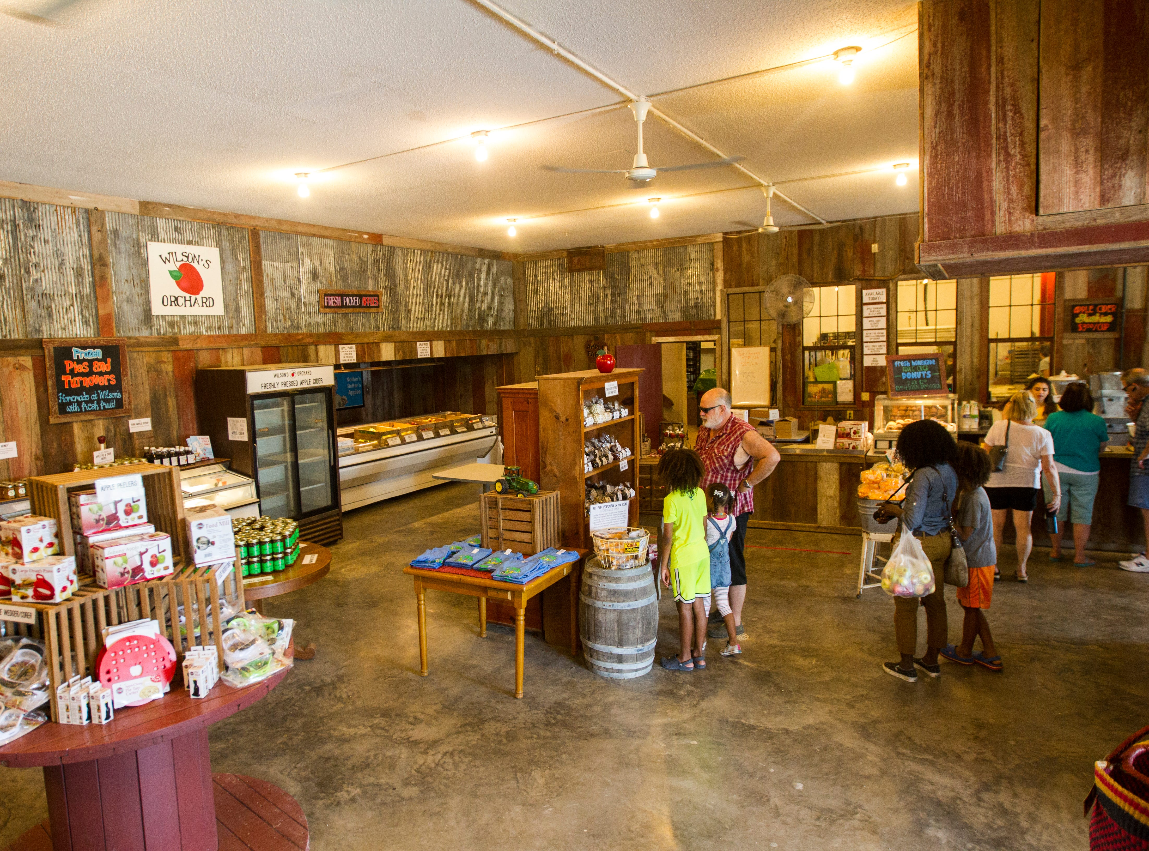 Customers shop inside on Wednesday, Aug. 1, 2018, at Wilson's Apple Orchard in Iowa City, Iowa. The orchard is open from Aug. 1 through Oct. 31, 10 a.m. to 6 p.m daily.