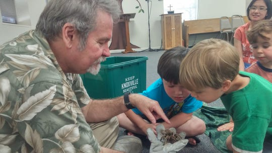 Lyn Bales from Ijams Nature Center shows a tarantula to participants in Vacation Bible School at The Church of the Good Shepherd in Fountain City, June 2018.