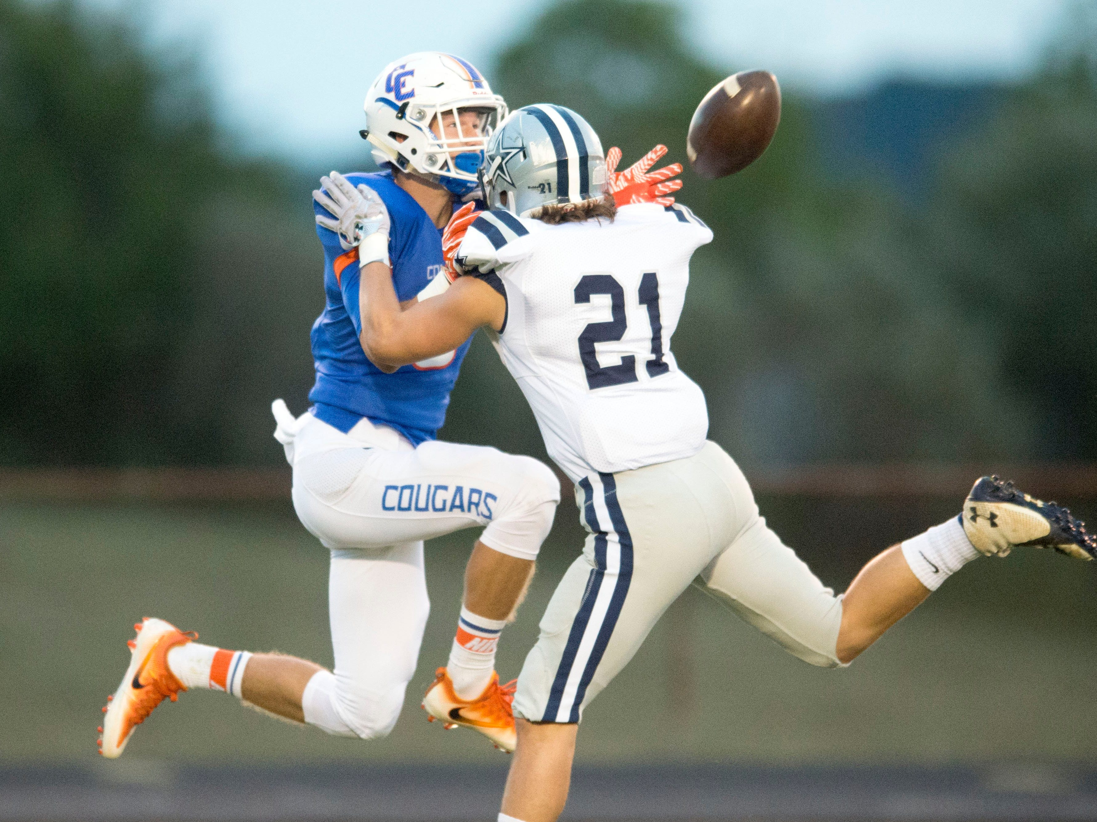 Campbell County's Logan Phillips misses a catch while defended by Farragut's Grayson Utterback at Campbell County High School on Thursday, September 29, 2016. Utterback was called for pass interference.