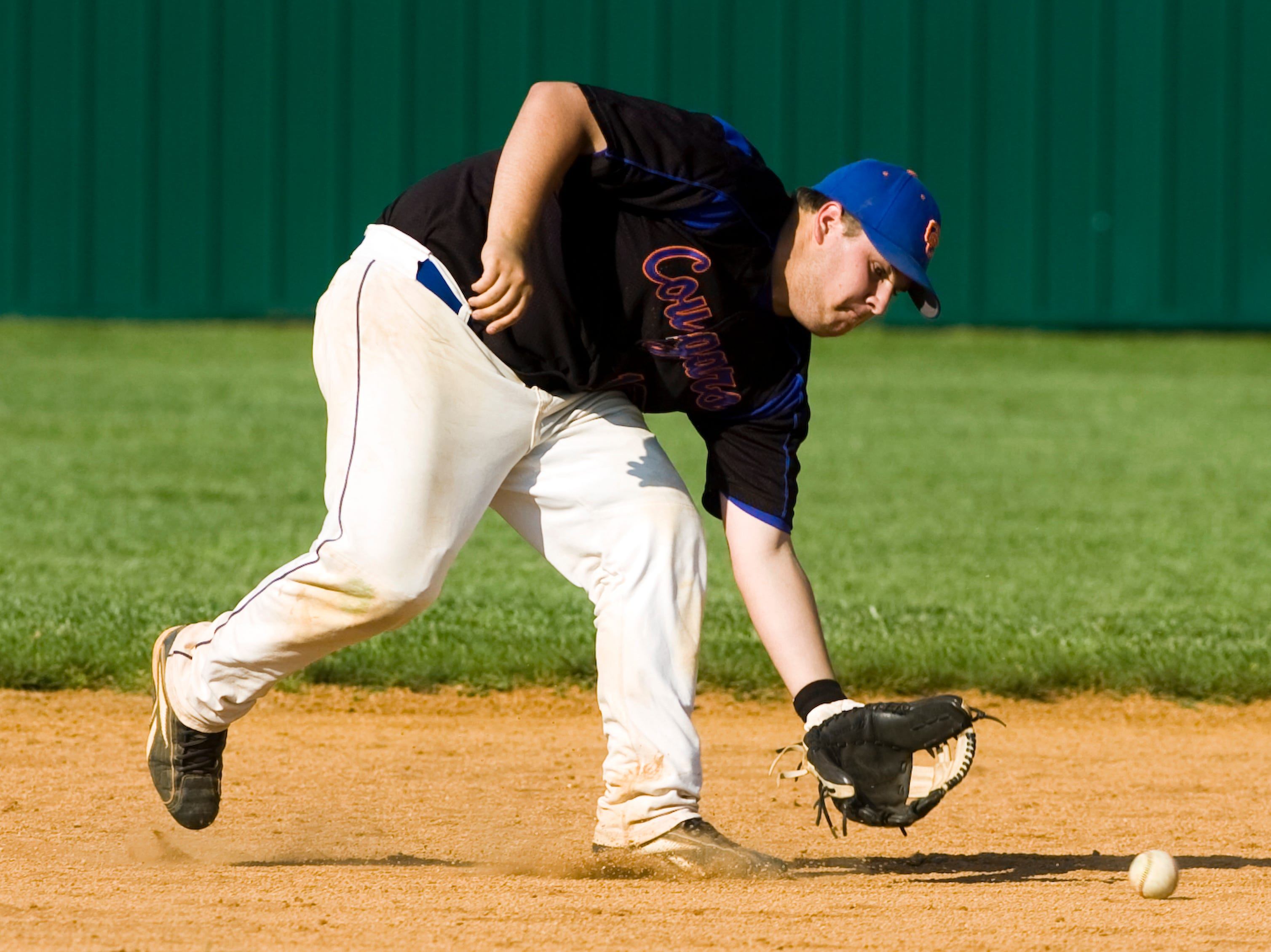 Campbell County's Billy Tindell goes after a ground hit. Halls defeats Campbell County 13-1 at Halls on Thursday, May. 6, 2010.