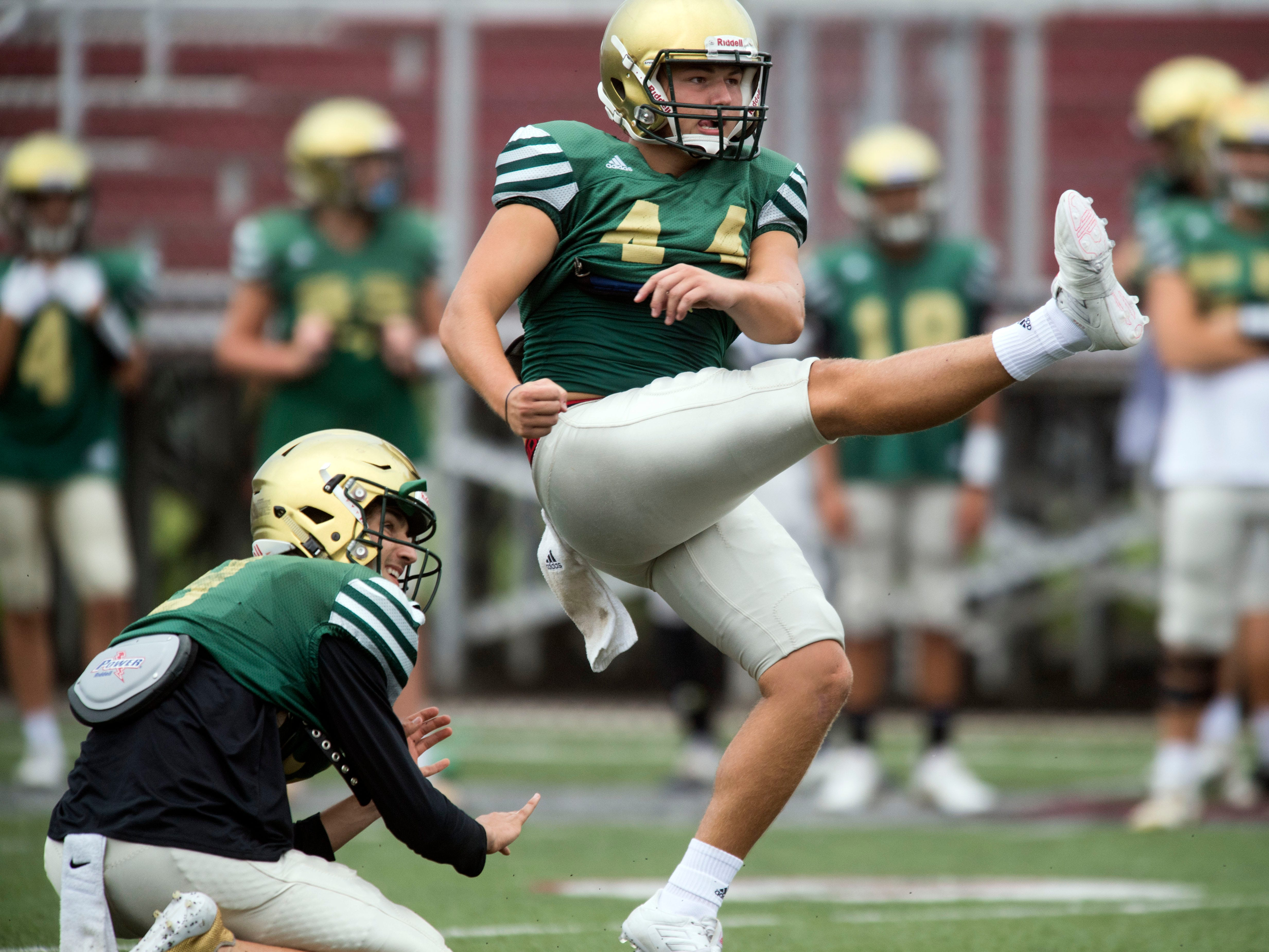 Knoxville Catholic's Landon Ray (44) practices field goals with Jack Jancek (3) before the start of a football scrimmage against Alcoa on Tuesday, July 31, 2018.