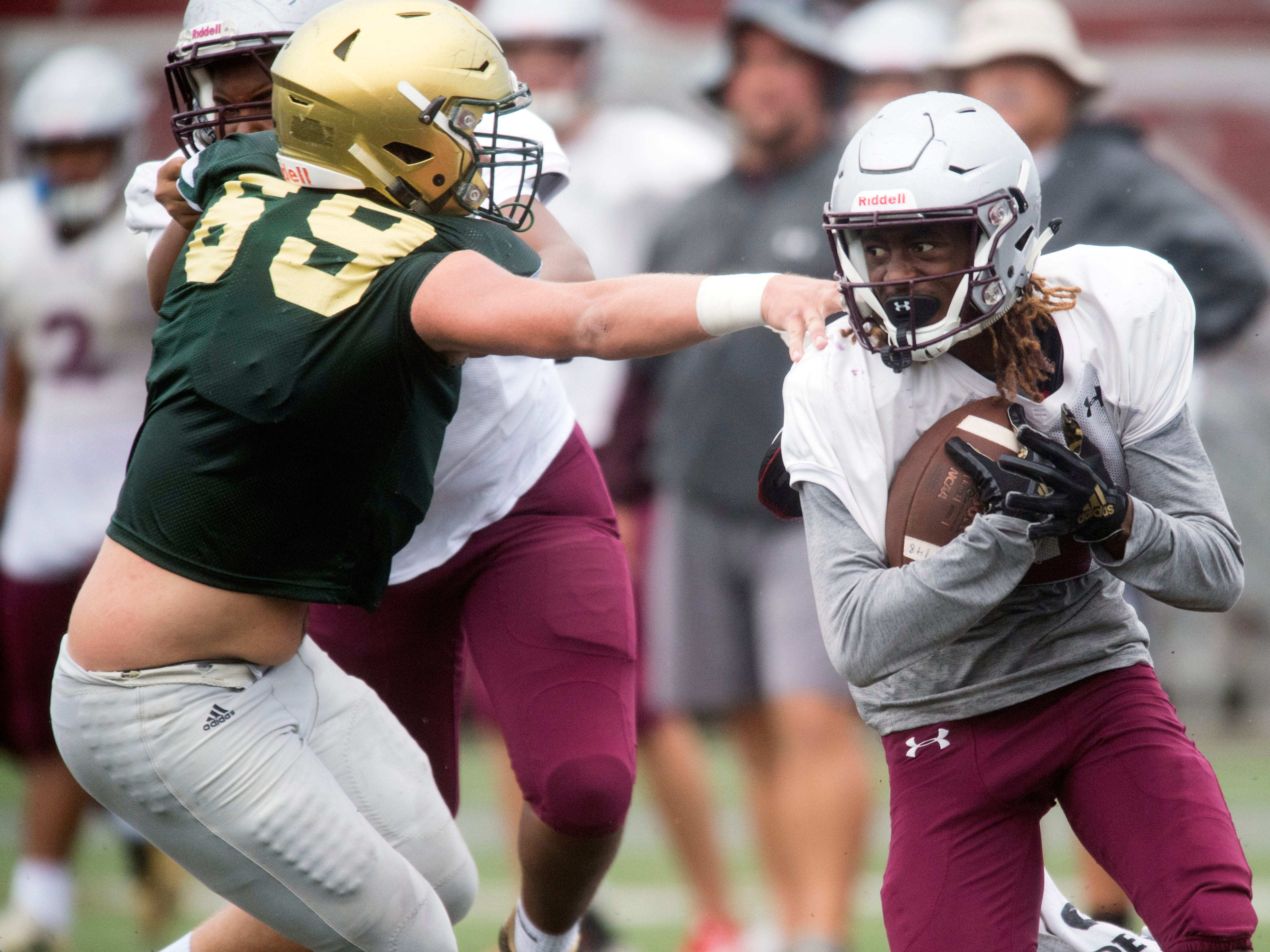 Alcoa's C.J. Armstrong (5) on a run against Knoxville Catholic during a football scrimmage on Tuesday, July 31, 2018.