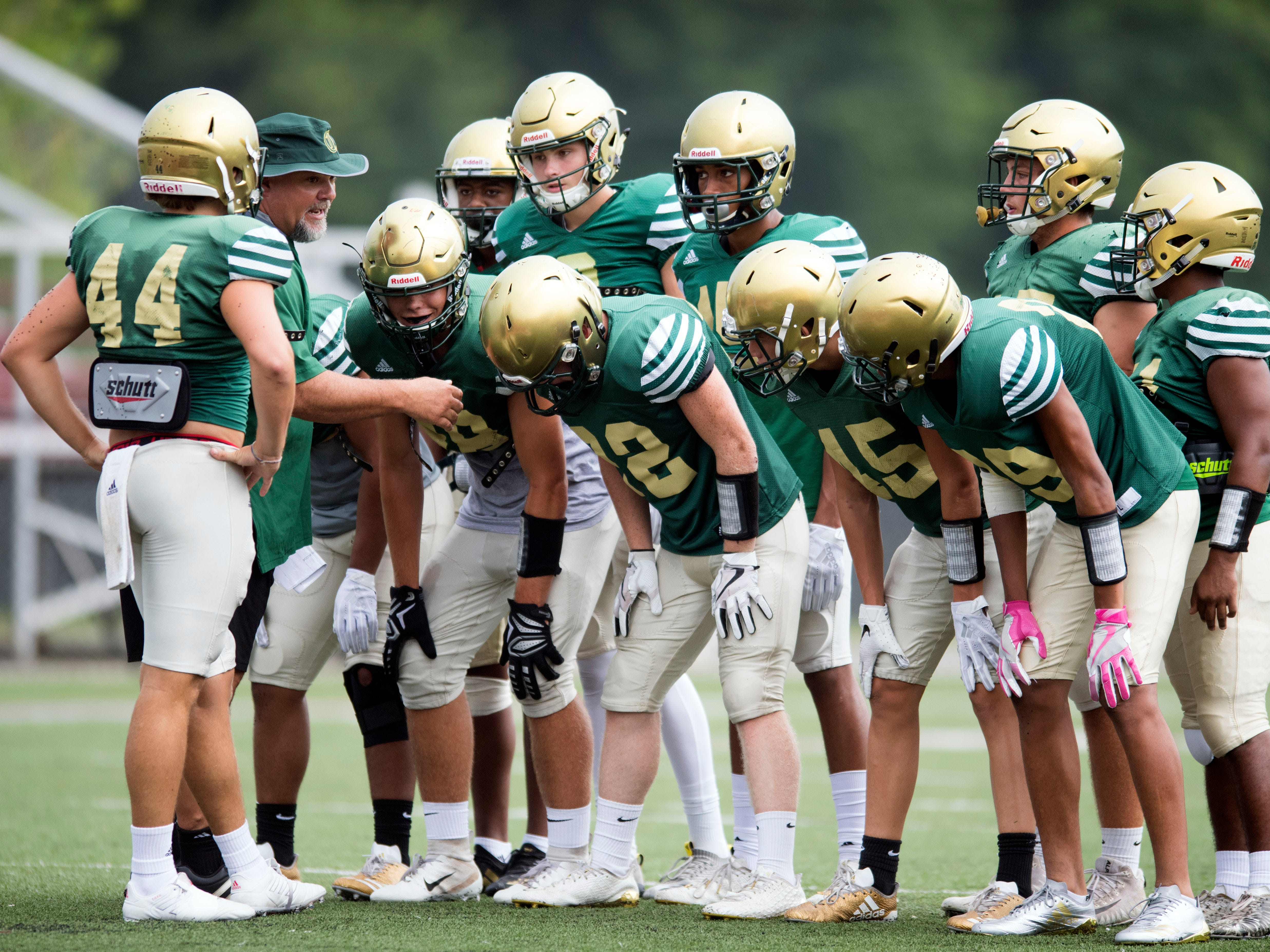 Knoxville Catholic's special teams huddle during during their football scrimmage at Alcoa on Tuesday, July 31, 2018.