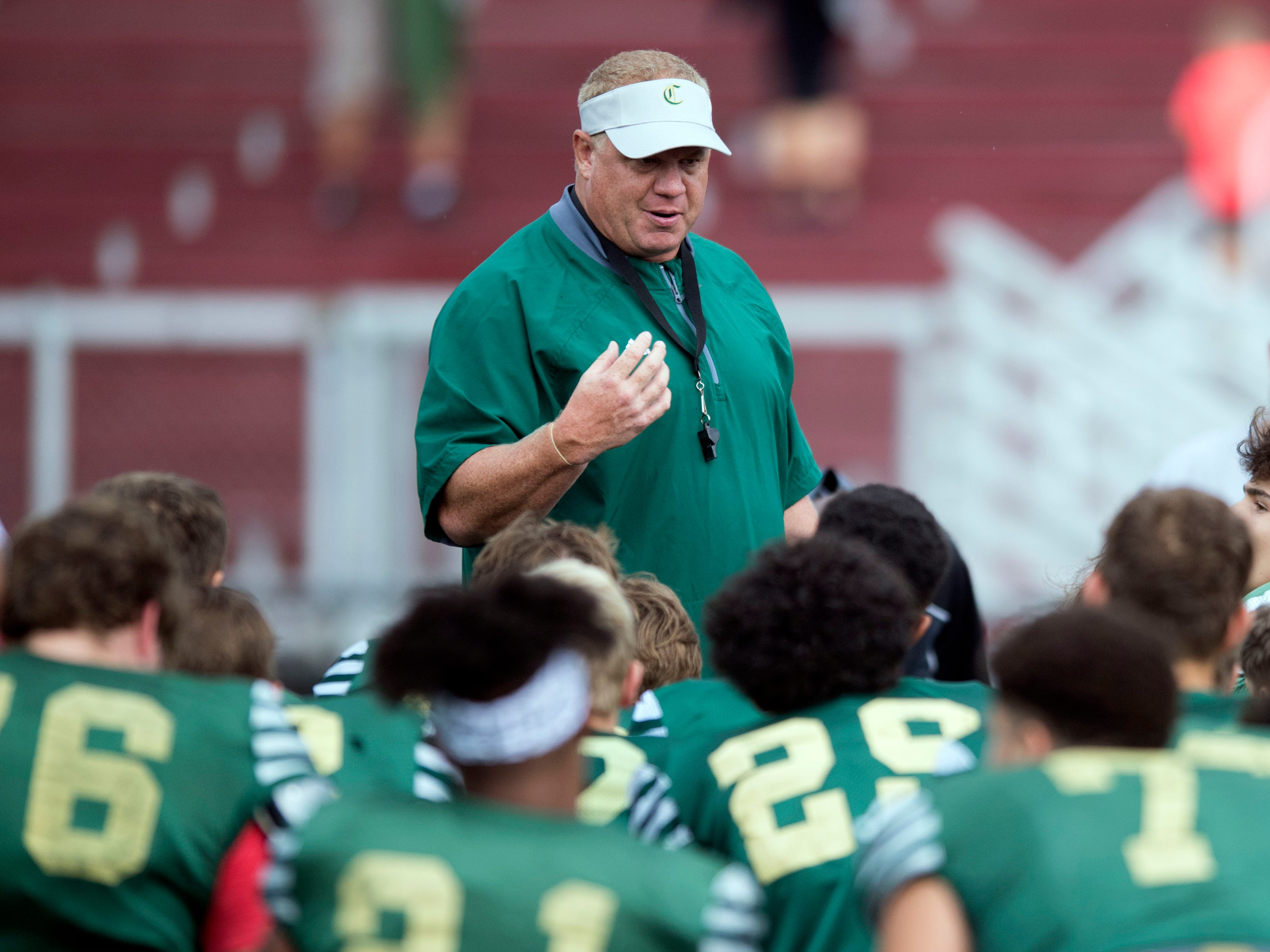 Knoxville Catholic coach Steve Matthews with the team before the start of their football scrimmage against Alcoa on Tuesday, July 31, 2018.
