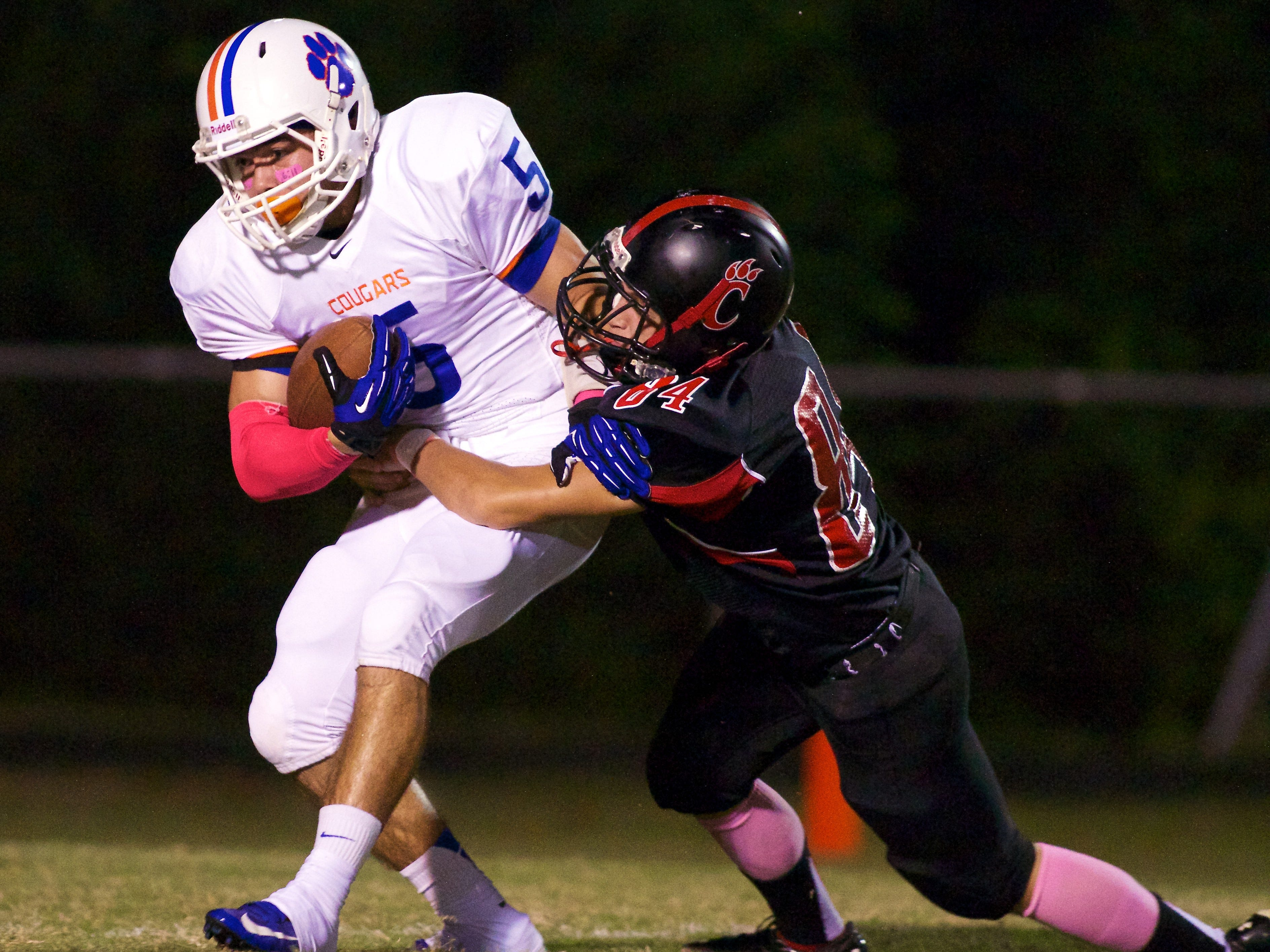 Campbell County's Bo Farris, left, tries to get away from Central's Josh Smith on Friday, October 5, 2012 at Central High School.