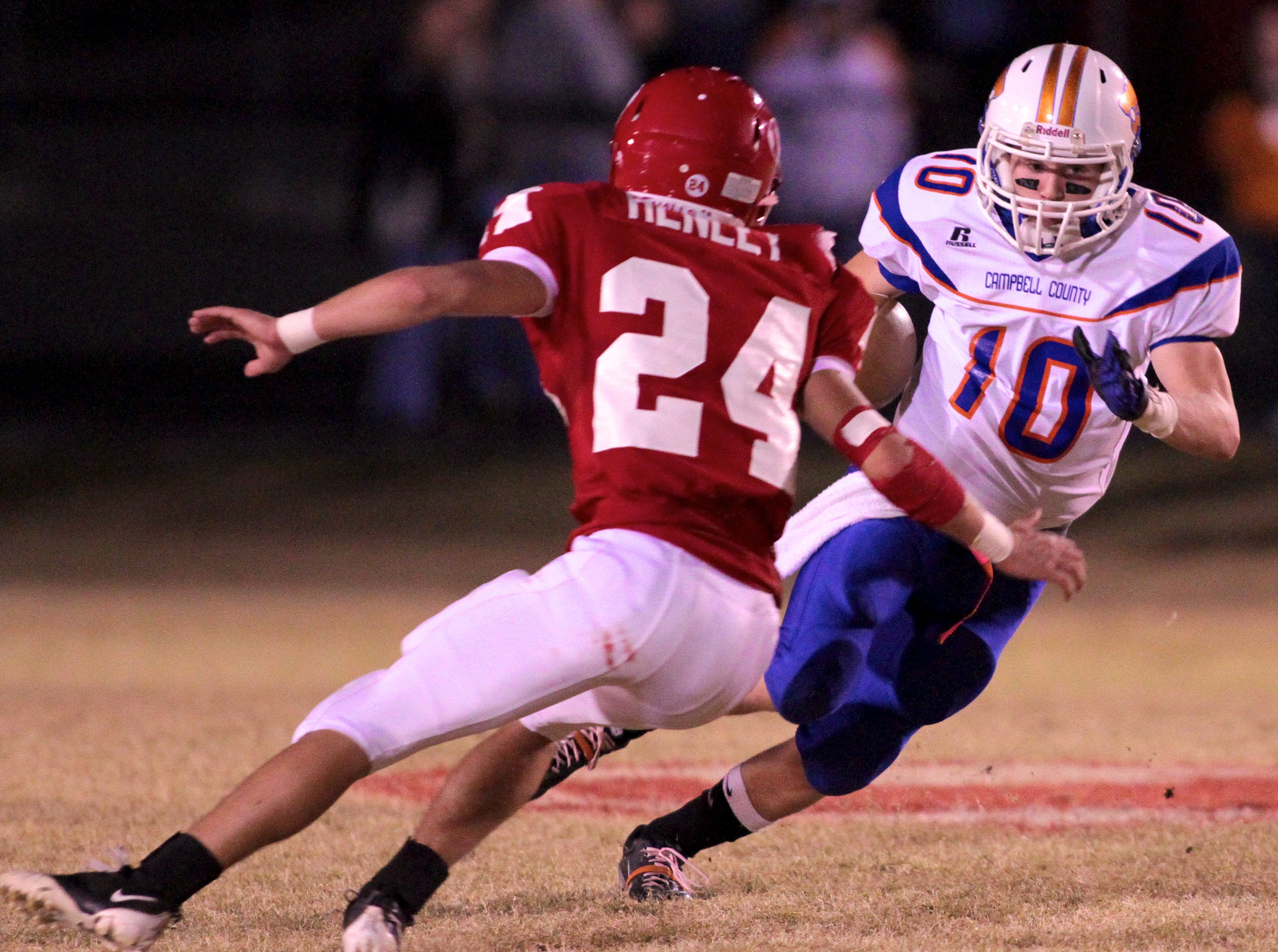 Halls' Donovan Henley, left, tries to stop Campbell County's Anthony Branam on Friday, October 22, 2010 at Halls High School.