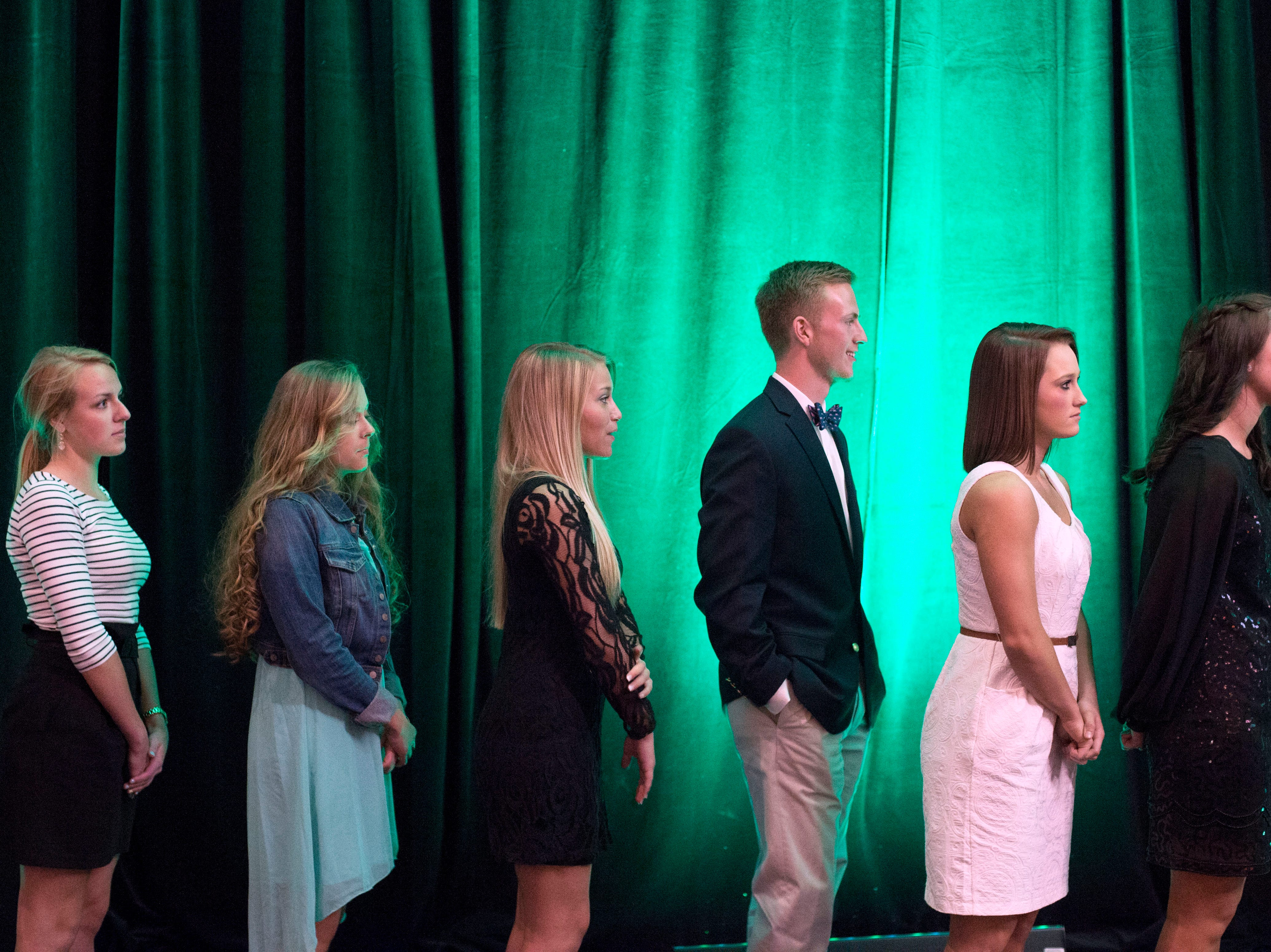 From right, Campbell County High School's Brooke Bane, Michaela Smith, Dakota Dossett, Bailey Doepel and Carter High School's Lindsey Fisher and Madeleine Helton wait in line to receive their awards during the Academic Achievers awards banquet at the Knoxville Convention Center on Thursday, April 23, 2015.