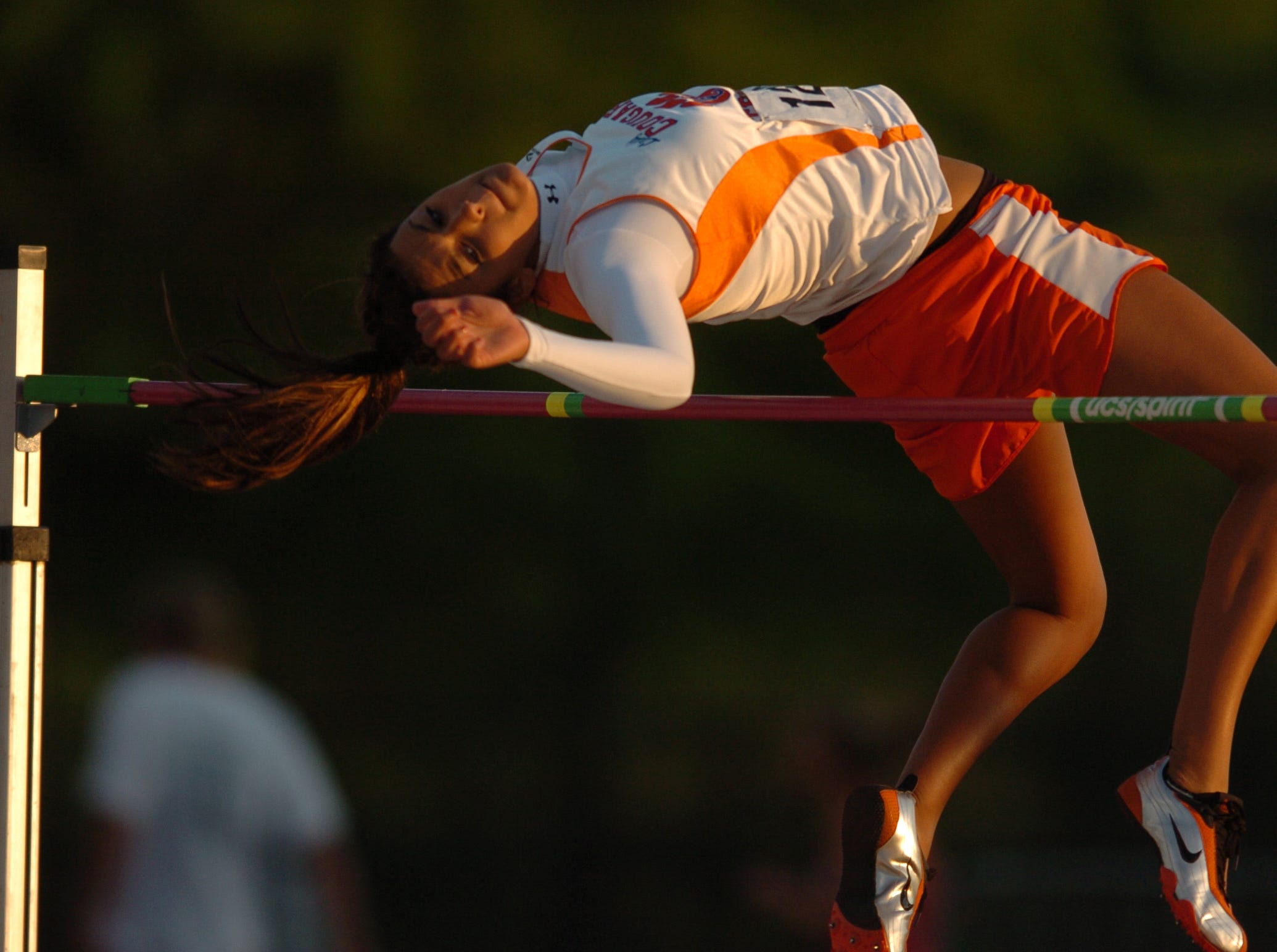 Alise Marlow of Campbell County clears the bar while competing in the girl's high jump during the PrepXtra Track and Field Invitational at Tom Black Track Tuesday night. 04/26/2005