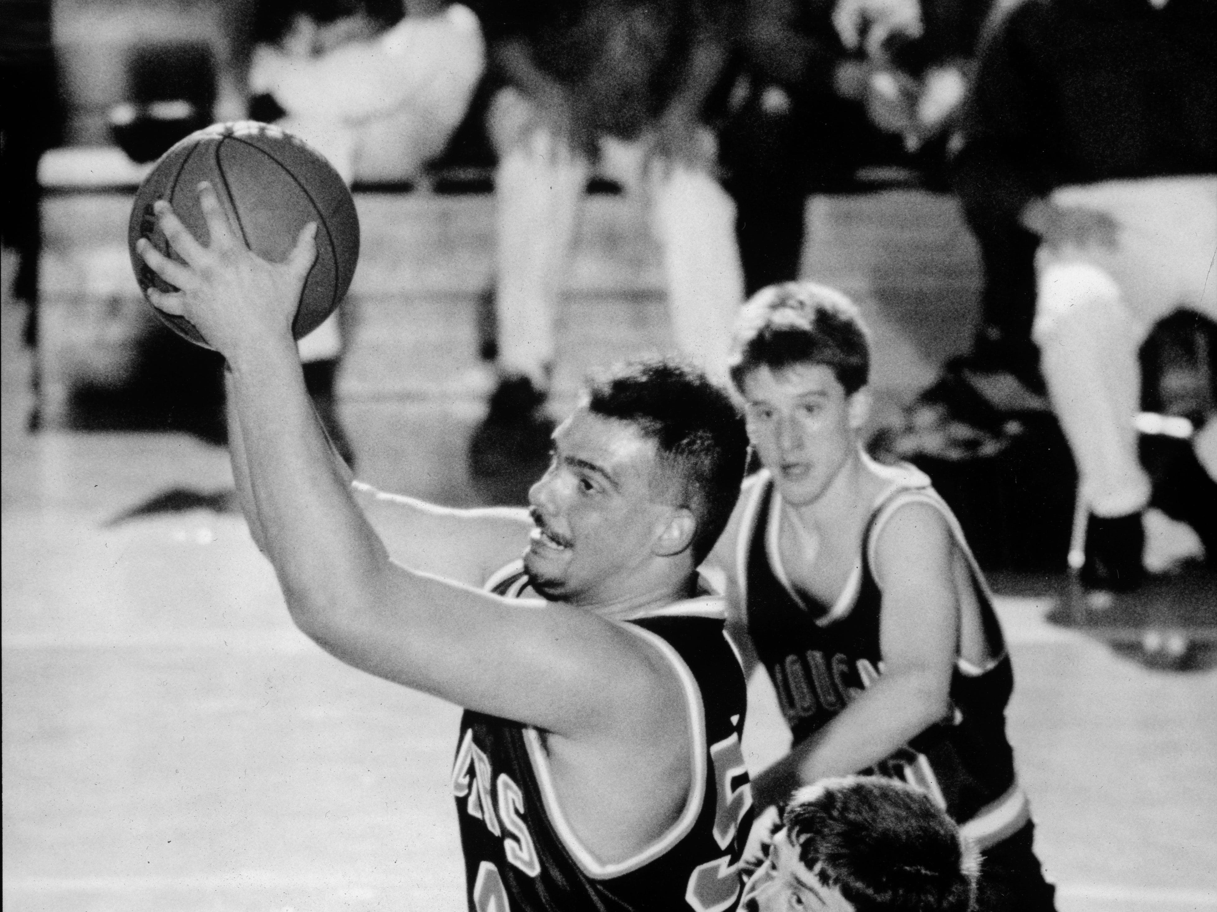 Campbell County High School's Bubba Miller comes down with the rebound during action against Lenoir City on March 3, 1992.