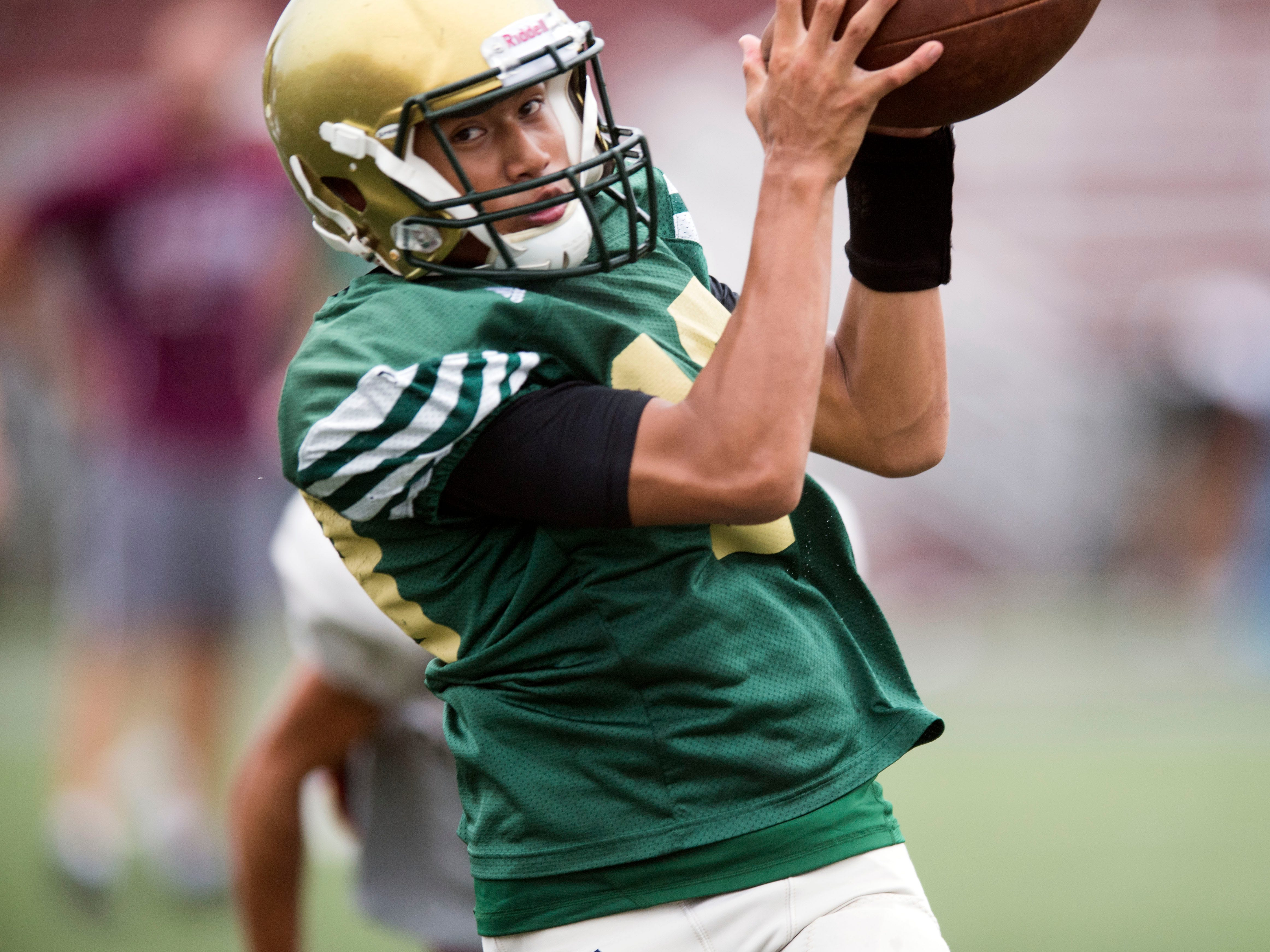 Knoxville Catholic's Ryan Beldyk (18) pulls down a pass during a football scrimmage against Alcoa on Tuesday, July 31, 2018.