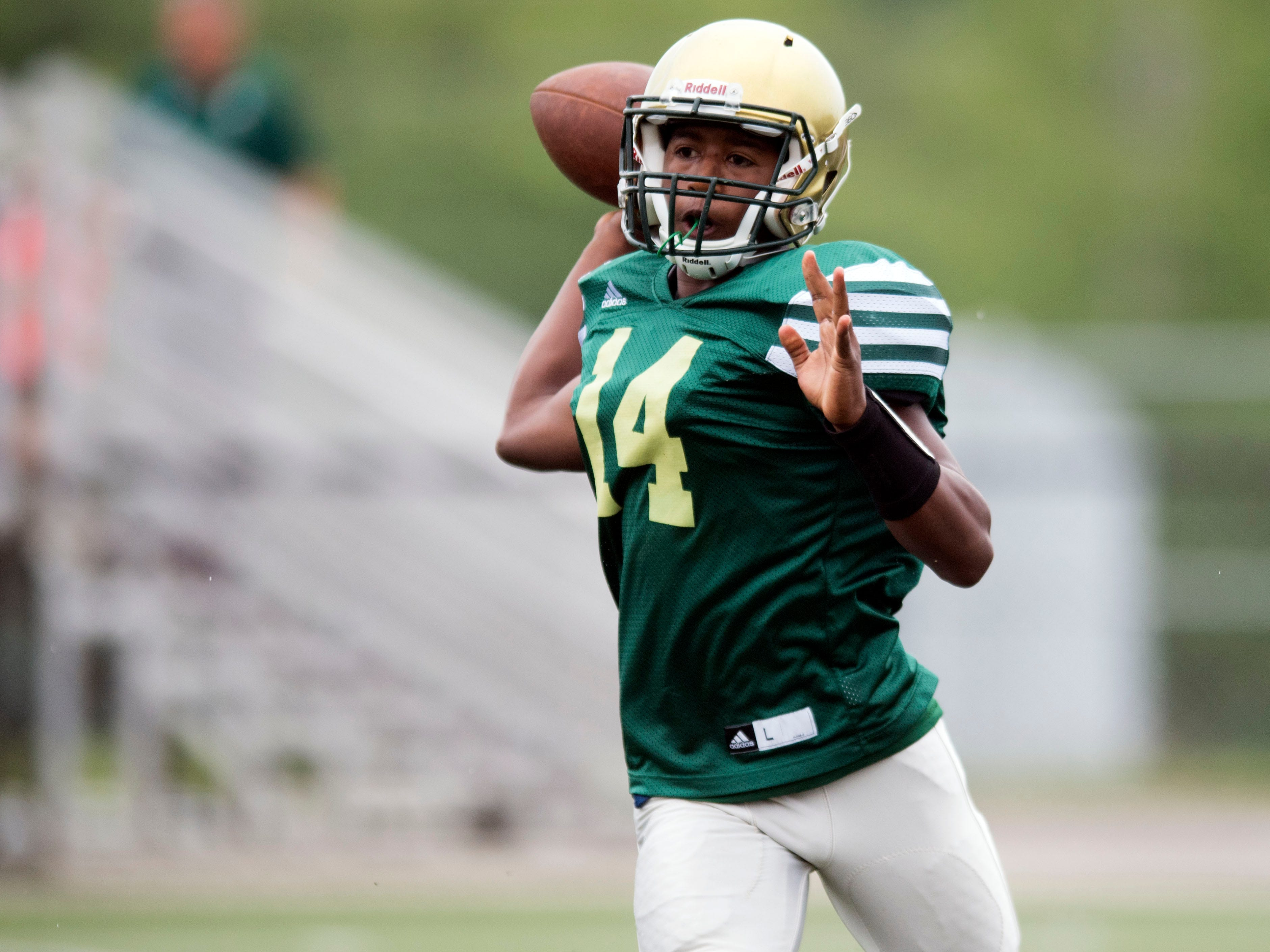 Knoxville Catholic's Paul Fisher (14) throws to a receiver during a football scrimmage against Alcoa on Tuesday, July 31, 2018.