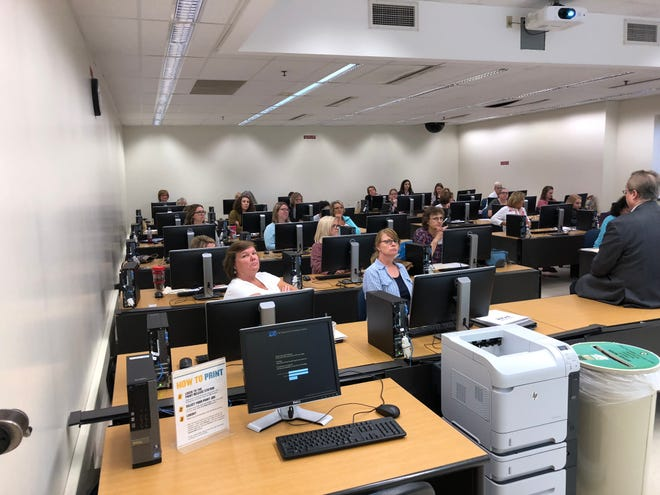 High school counselors in Indiana came to Purdue University to learn about a data visualization tool and a video game to teach students about careers.