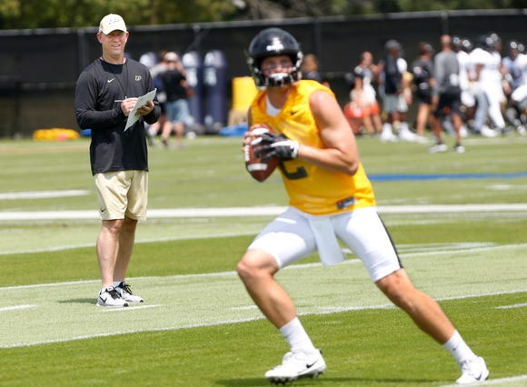 Head coach Jeff Brohm looks on as quarterback Elijah Sindelar runs a drill during football practice Wednesday, August 1, 2018, at Purdue.