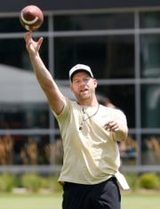 Quarterbacks coach and co-offensive coordinator Brian Brohm works with the quarterbacks during football practice Wednesday, August 1, 2018, at Purdue.