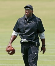 Wide receivers coach and co-offensive coordinator Jamarcus Shephard shouts instructions to the wide receivers during football practice Wednesday, August 1, 2018, at Purdue.