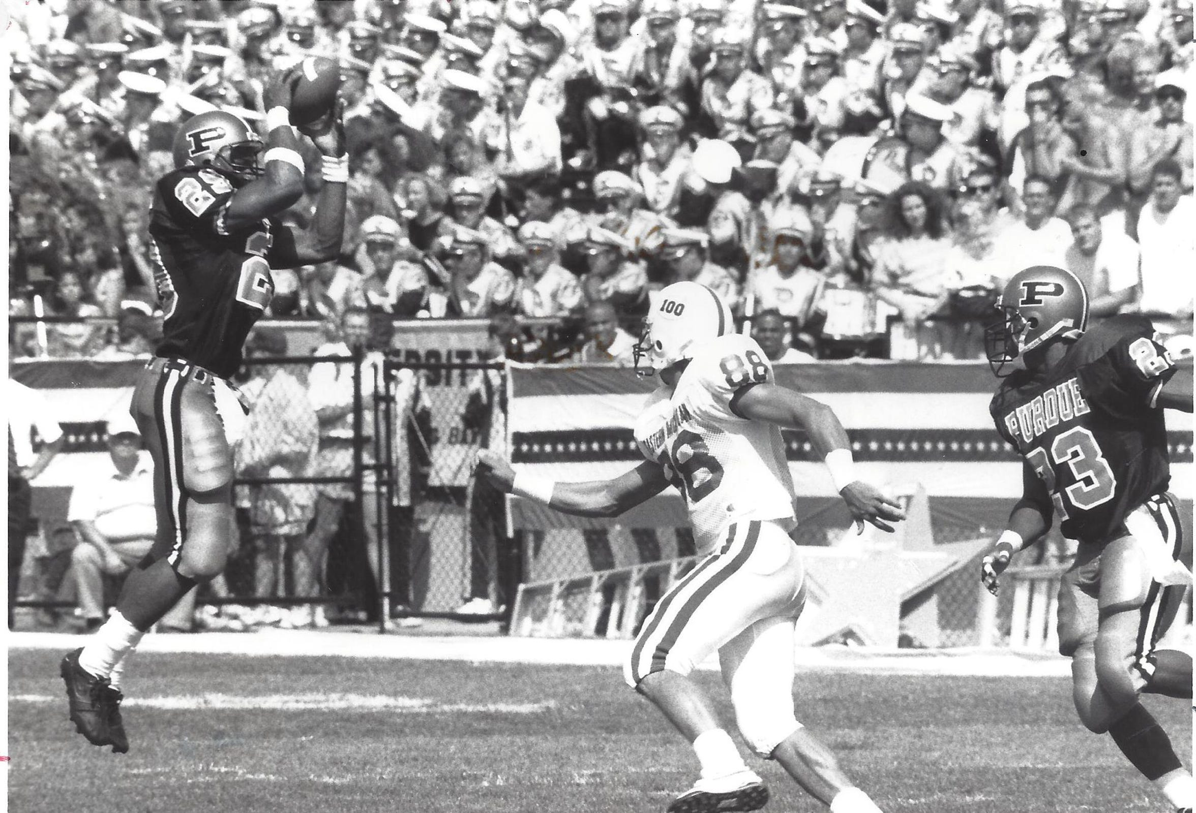 Purdue safety Pat Johnson corrals an interception during an early 1990s game at Ross-Ade Stadium.