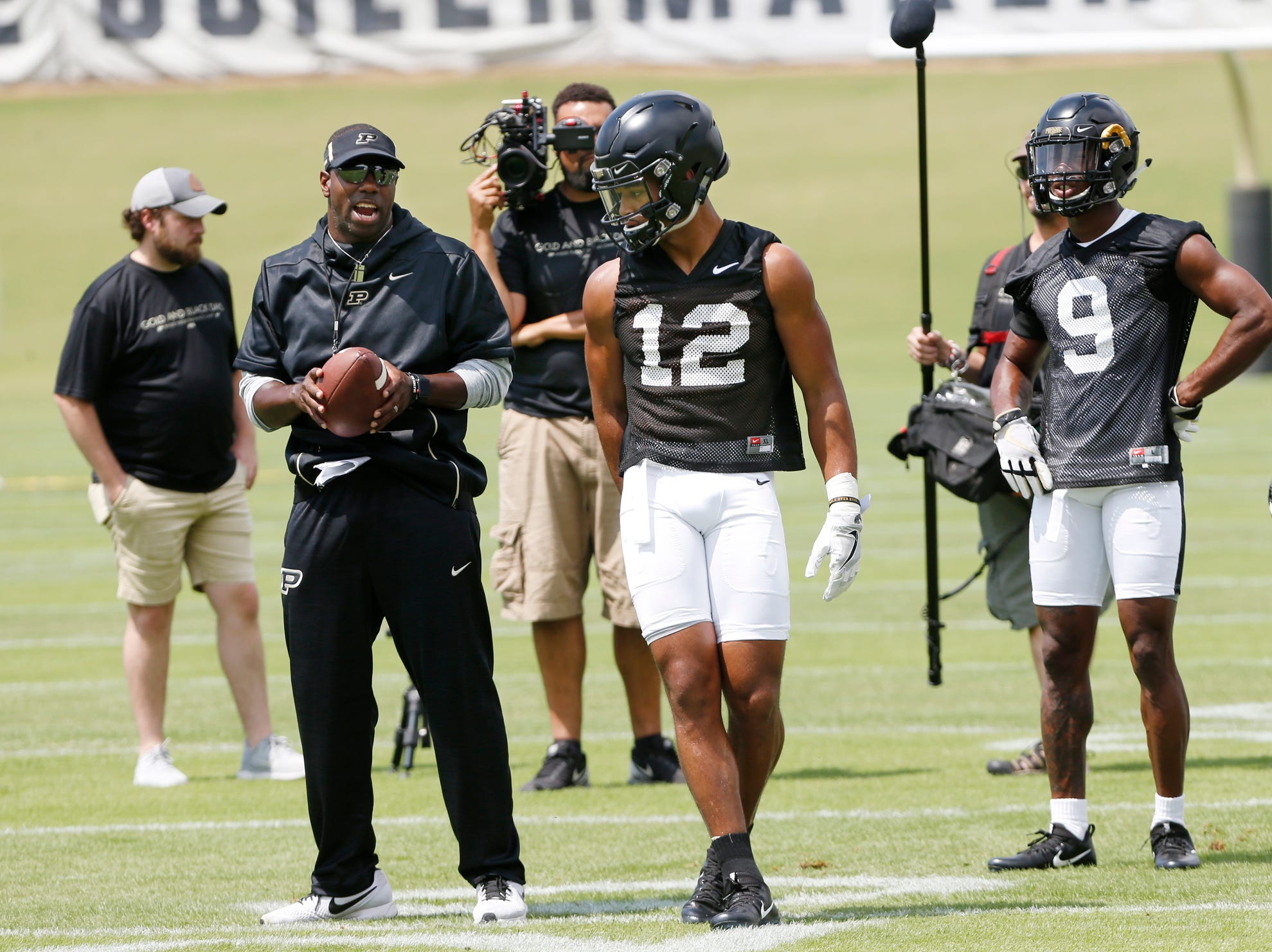 Wide receivers coach and co-offensive coordinator Jamarcus Shephard tells wide receiver Jared Sparks which pass route to run during football practice Wednesday, August 1, 2018, at Purdue.