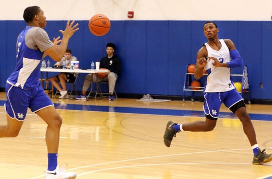 Kentucky's Keldon Johnson, left, and Ashton Hagans run through a drill during the team's practice at the Craft Center in Lexington. Aug. 1, 2018
