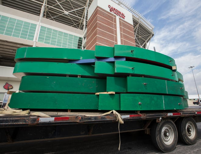 Papa John's Pizza signs sit on a flat bed trailer after being removed from Cardinal Stadium this morning. Aug. 1, 2018.