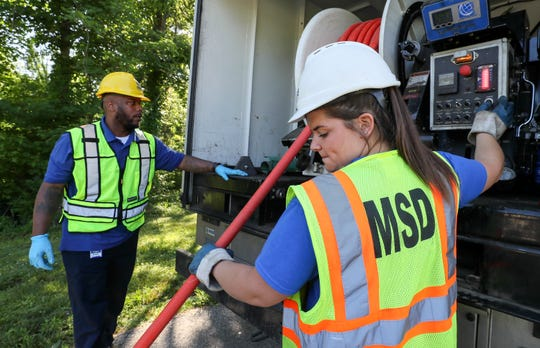 JCPS graduate and MSD employee Megan McWilliams works with supervisor Tony Woods in south Louisville.May 23, 2018