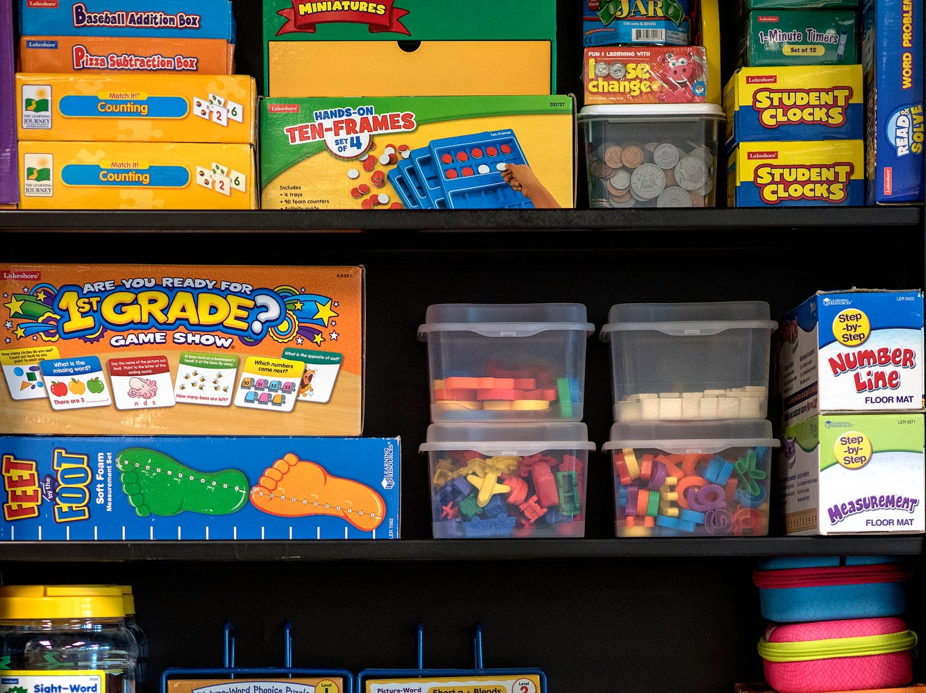 Various educational games and materials are stored on a shelf photographed on Wednesday, Aug. 1, 2018, at Cole Academy's East Lansing campus. The school, Cole Academy's second campus, is opening this fall.