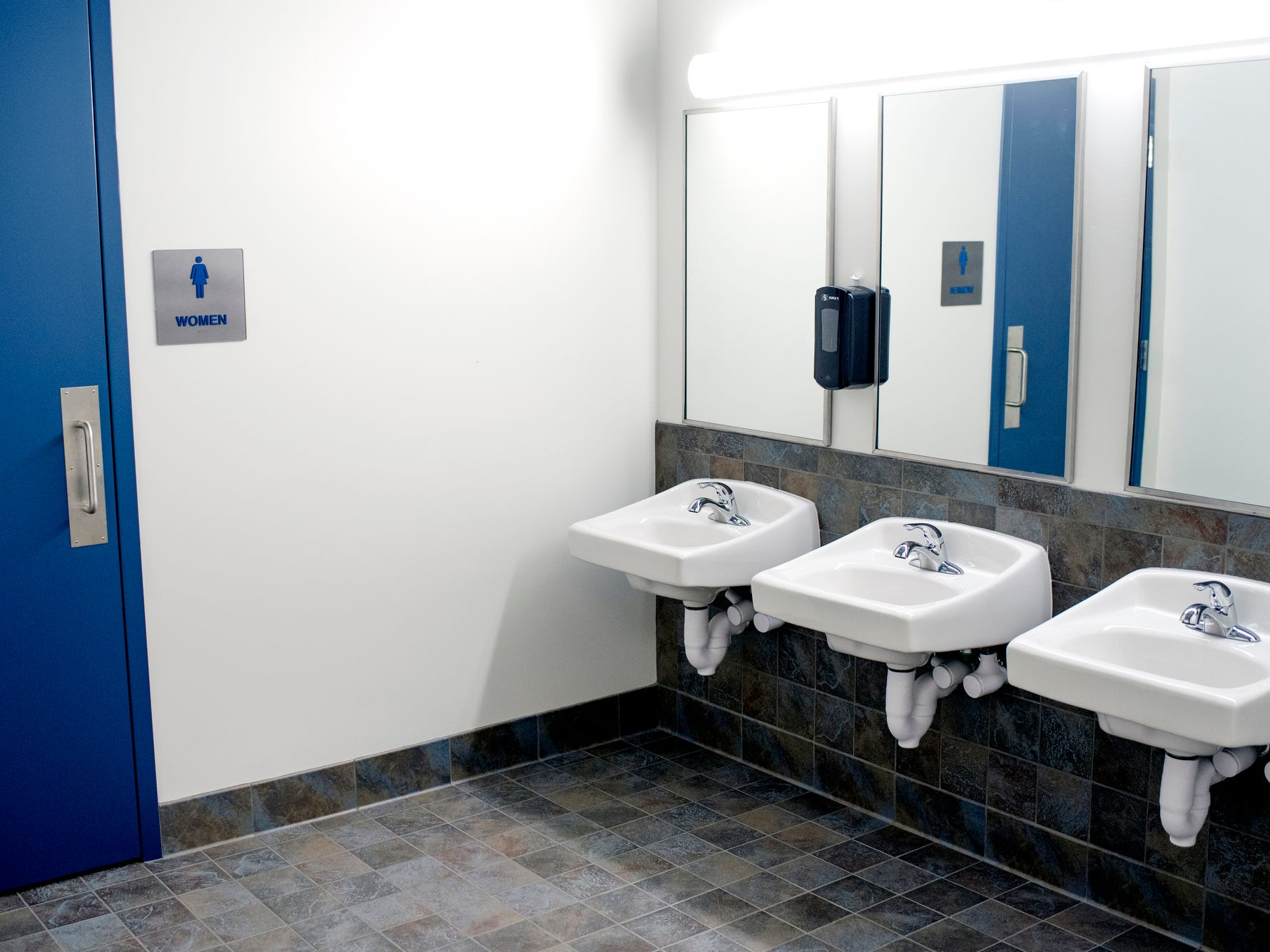 The washing area of the bathrooms is in an open space at Cole Academy's East Lansing campus. The school, Cole Academy's second campus, is opening this fall.