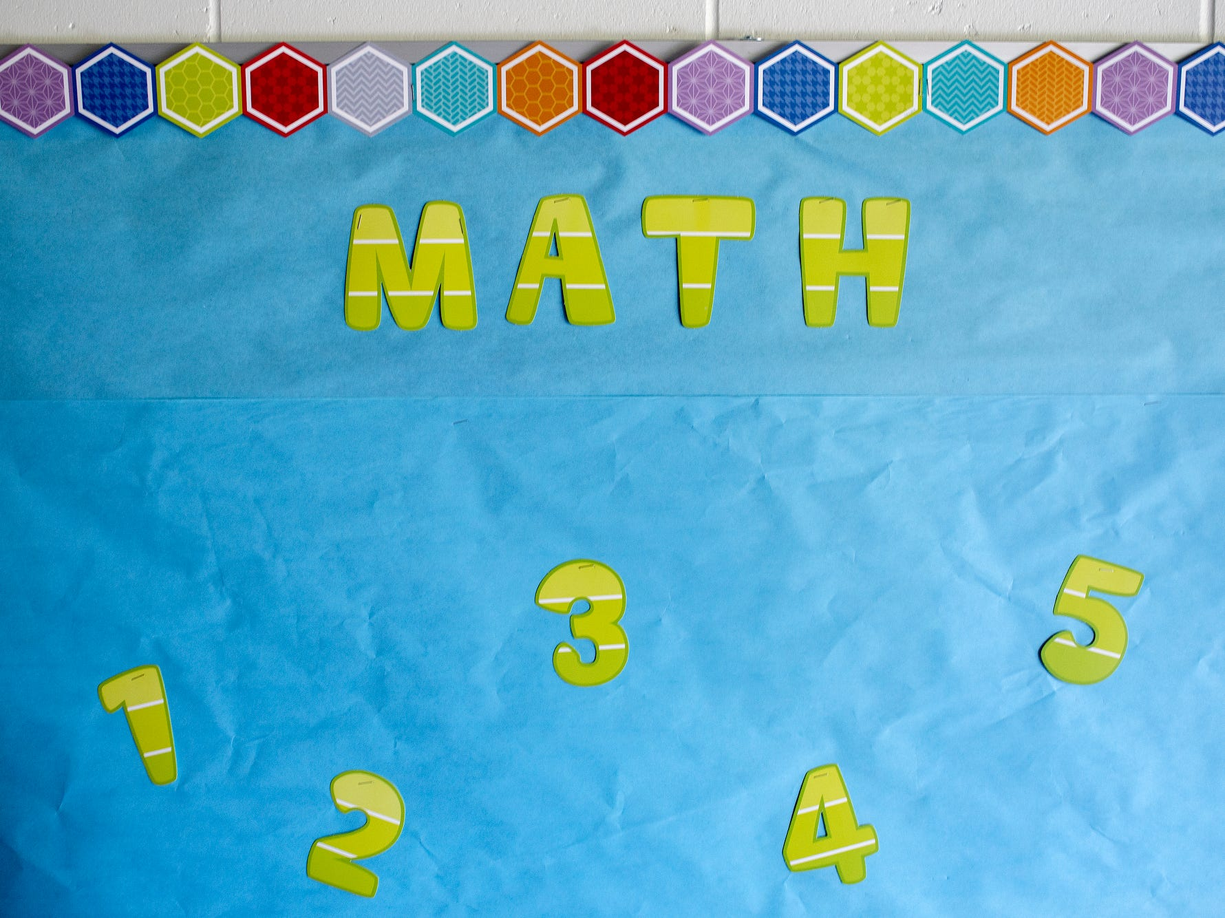 A bulletin board for the subject of math hangs in a classroom on Wednesday, Aug. 1, 2018, at Cole Academy's East Lansing campus. The school, Cole Academy's second campus, is opening this fall.