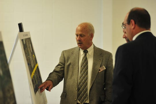 Visitors look over changes to the US 30 reconstruction project that's slated for completion in late 2022.