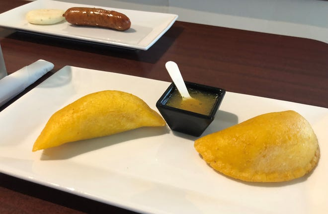 Foreground, empanadas; background, chorizo and small arepa from The Colombian Kitchen, Bonita Springs.