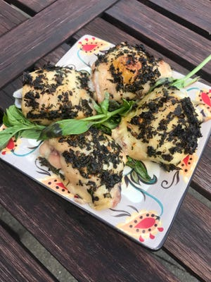 Chicken thighs coated in herbs and baked are a flavorful, easy main dish for family dinner.