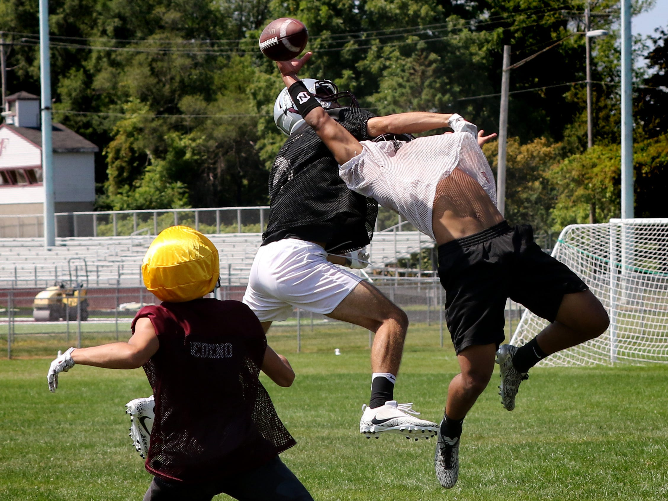 A pass play is broken up for an interception during Menomonee Falls football team's second day of practice on Aug. 1.