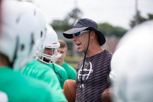 Greendale head coach Rob Stoltz talks to his players on the first day of practice Wednesday.