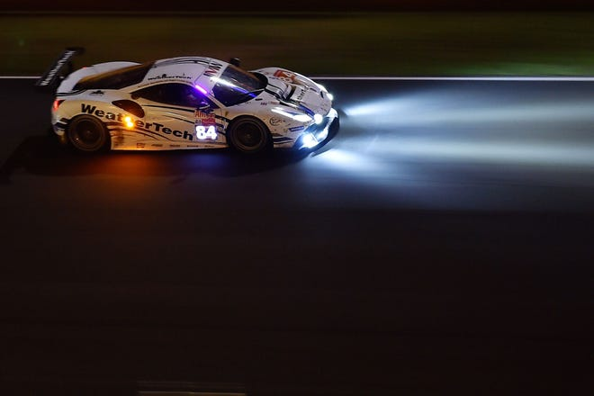 Cooper MacNeil competes during the 86th Le Mans 24-hours endurance race, at the Circuit de la Sarthe at night on June 17, 2018. MacNeil  and his teammates finished fifth in their class.