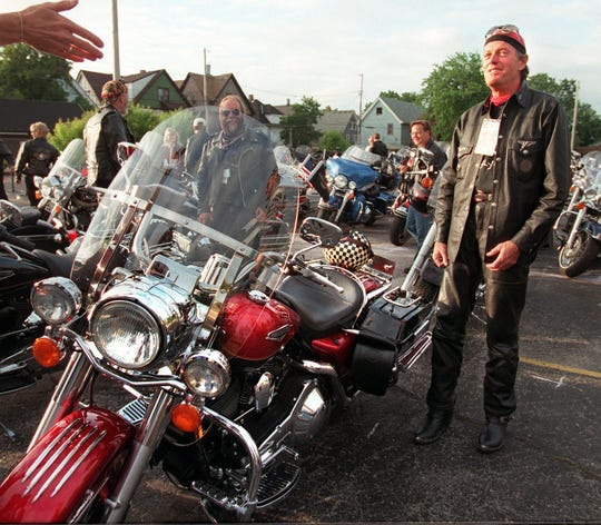 "Actor Peter Fonda - whose memorable roles including riding a Harley in the landmark 1969 movie ""Easy Rider"" - prepares for the ride at the VIP staging area at the 95th Harley-Davidson anniversary celebration on June 13, 1998. This photo was published in the June 14, 1998, Milwaukee Journal Sentinel."