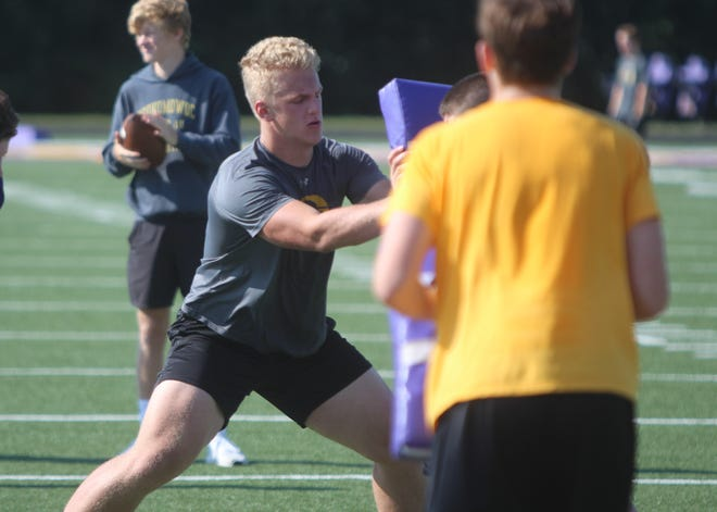 Oconomowoc tackle Leif Engstrand blocks in a practice drill on August 1.