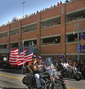 2008: Watching from a four-story parking ramp, spectators cheer as riders pass through downtown Milwaukee during the Harley-Davidson 105th anniversary parade on Aug. 30, 2008.