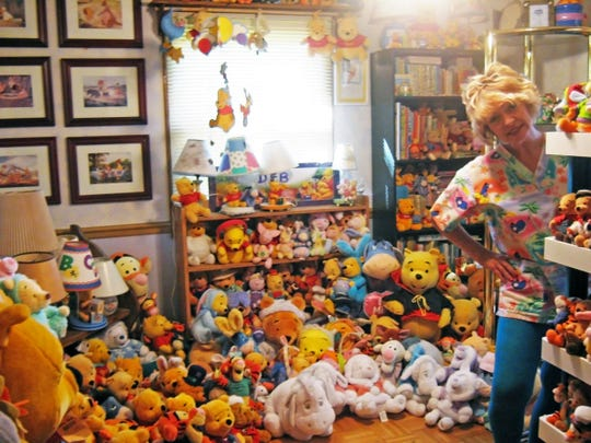 In this 2013 photo, Deb Hoffmann of Vernon stands in one of three rooms dedicated to Winnie the Pooh merchandise. Her collection includes more than 10,000 items.