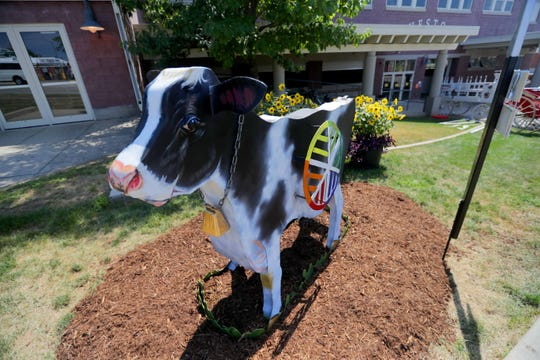 A cow on the Cow-Temporary Art Walk  is one of several that are spread out across the grounds. Fairgoers can pick up a punch card for the walk at the Young People's Art Exhibit in the lobby of the Exposition Center.