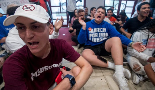 Adam Alahanti chants as survivors from the Parkland School shooting and gun violence protestors hold a sit in at the Alabama Statehouse in Montgomery, Ala. on Wednesday August 31, 2018 after not being allowed further into the building during their Road to Change Tour.