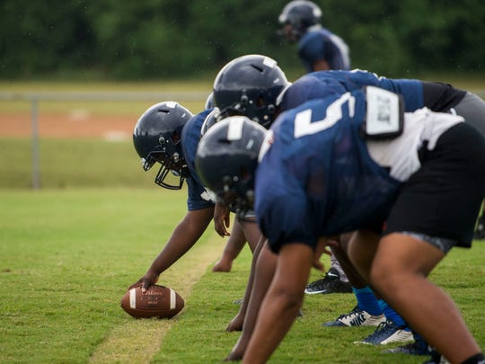 Success Unlimited Academy offensive players line up during their first football practice in pads Wednesday, Aug. 1, 2018, at True Divine Baptist Church in Montgomery, Ala. The Mustangs will enter their first season of varsity football this fall.