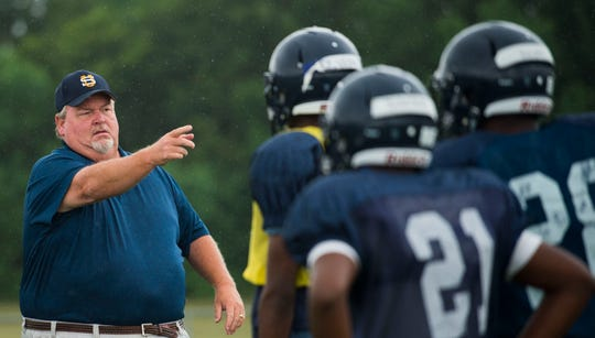 Success Unlimited Academy head coach Bill Granger talks to players during their first football practice in pads Wednesday, Aug. 1, 2018, at True Divine Baptist Church in Montgomery, Ala. The Mustangs will enter their first season of varsity football this fall.