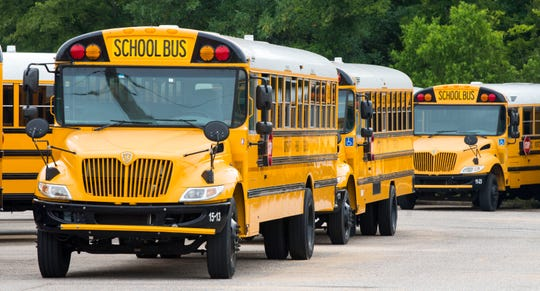 Montgomery Public School buses ready for the school year Wednesday, Aug. 1, 2018, in Montgomery, Ala.